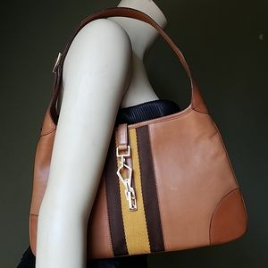 Gucci Jackie Leather hobo bag w/ metal claw clasp